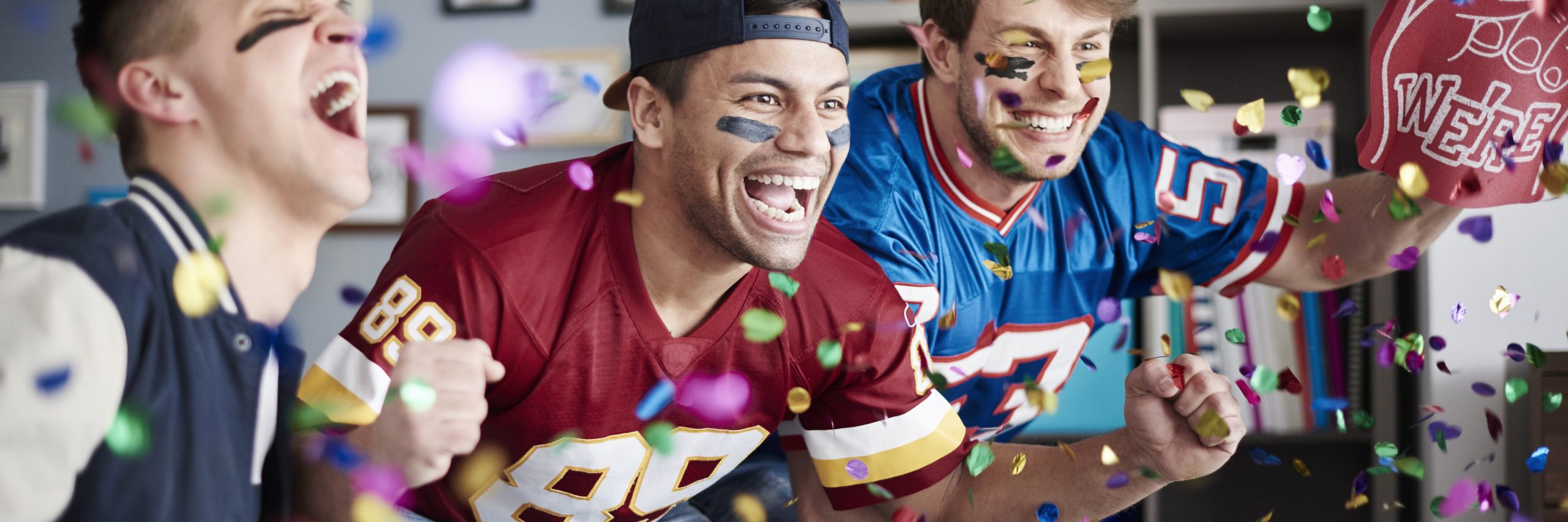 Football fans cheering for the Super Bowl.